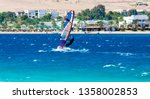windsurfer rides on the... | Shutterstock . vector #1358002853