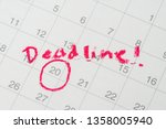 Small photo of Desktop calendar with red circle on important date with handwriting deadline, goal or target date of work project plan, meeting or day of delivery.