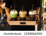 men holding beverage drinks...   Shutterstock . vector #1358066540