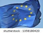 european flag flying on a... | Shutterstock . vector #1358180420