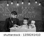 father with beard  teacher... | Shutterstock . vector #1358241410