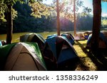 tent of tourists in forest with ... | Shutterstock . vector #1358336249