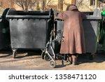 elderly woman in winter coat is ... | Shutterstock . vector #1358471120