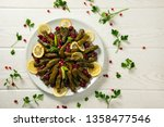 stuffed wine leaves. cherry and ...   Shutterstock . vector #1358477546
