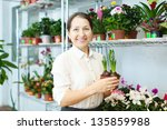 happy  woman with hyacinth ... | Shutterstock . vector #135859988