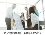 business team standing next to...   Shutterstock . vector #1358659349