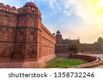 red fort delhi at sunrise with... | Shutterstock . vector #1358732246
