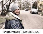 Poor Homeless Man Standing On...