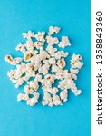 popcorn on blue background | Shutterstock . vector #1358843360