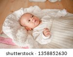 cute baby boy in a white light... | Shutterstock . vector #1358852630