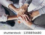 four team members expressing... | Shutterstock . vector #1358856680