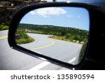 Curved Road In The Car Mirror