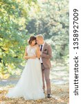 elegant stylish groom gently... | Shutterstock . vector #1358927009
