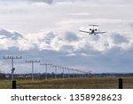 an airplane landing not really... | Shutterstock . vector #1358928623