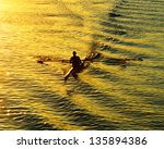 rowing alone at sunset | Shutterstock . vector #135894386