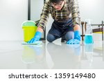 man with cloth cleaning floor... | Shutterstock . vector #1359149480