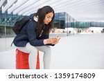 serious busy young woman using... | Shutterstock . vector #1359174809