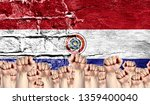 male hands clenched in a fist... | Shutterstock . vector #1359400040