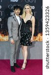 Small photo of New York, NY - April 3, 2019: Joe Jonas and Sophie Turner attend HBO Game of Thrones final season premiere at Radio City Music Hall