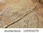 Cup and ring marks on a stone near Cairnbaan in Scotland - stock photo