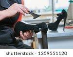shoemaker repair female spike... | Shutterstock . vector #1359551120