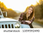 a young attractive woman poses... | Shutterstock . vector #1359592490