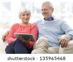 senior couple with digital... | Shutterstock . vector #135965468