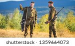 Small photo of Hunting with partner provide greater safety fun and rewarding. Gamekeeper rifles nature environment. Gamekeepers walk mountains background. Gamekeepers sunny fall day. Gamekeeper occupation concept.