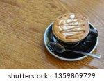 caramel macchiato in black cup... | Shutterstock . vector #1359809729