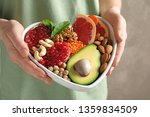 woman holding bowl with... | Shutterstock . vector #1359834509