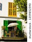 balcony with sun umbrella and... | Shutterstock . vector #1359852590