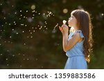 Cute Little Girl Blowing On A...