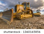 Small photo of Excavator and steamroller work in the realization of a road