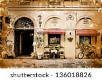 Photo in retro style. Paper texture./Aged textured photo with Italian cities - stock photo
