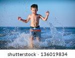 Cute Little Boy Running Throug...