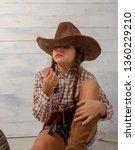 a little girl in a wide brimmed ... | Shutterstock . vector #1360229210