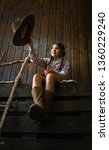 little girl in a wide brimmed... | Shutterstock . vector #1360229240