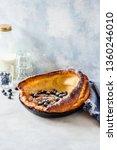 dutch baby with blueberries ... | Shutterstock . vector #1360246010