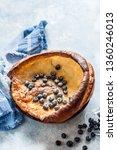 dutch baby with blueberries ... | Shutterstock . vector #1360246013