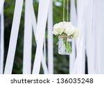 white roses in a glass vase... | Shutterstock . vector #136035248