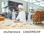 a woman baker smileswith... | Shutterstock . vector #1360398149