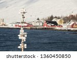 Scenics view of eskifjordur city in eastern iceland.winter season in iceland ( Text on sign is name of other city around the world direction)