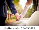 bride and groom holding hands | Shutterstock . vector #136055429