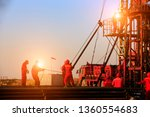 the oil workers are working | Shutterstock . vector #1360554683