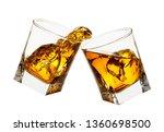 glasses of whiskey making toast with splashes isolated on white background