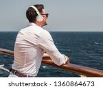 fashionable man listening to... | Shutterstock . vector #1360864673