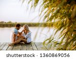 loving couple sitting on the... | Shutterstock . vector #1360869056