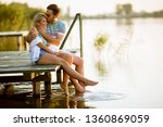 loving couple sitting on the... | Shutterstock . vector #1360869059