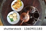 Small photo of teh poci, jadah bakar dan pisang goreng or black tea in the clay pot with misbegotten fuel and fried banana is javanese traditional food and drink