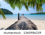 palm leaf at sunny day tropical ... | Shutterstock . vector #1360986239